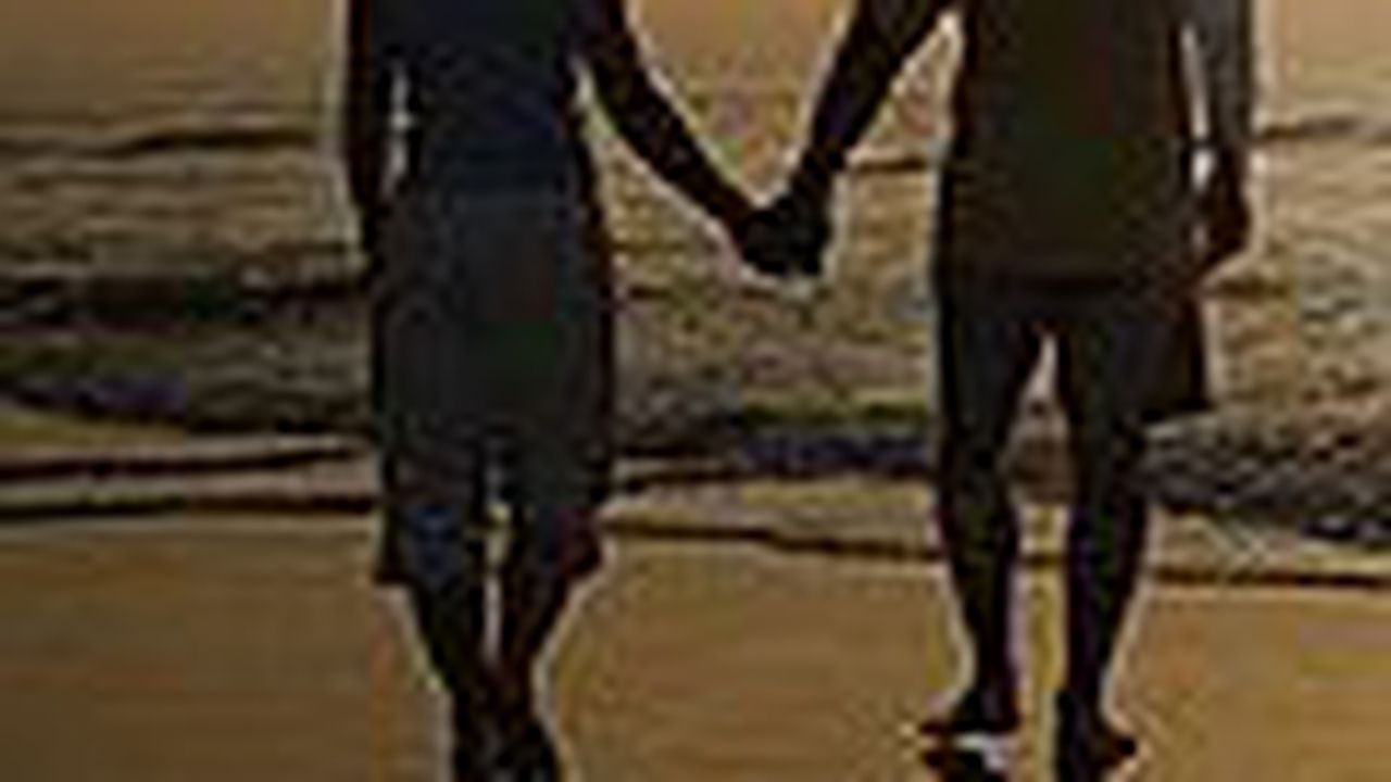 10447_1356365292_couple-walking-on-beach-at-sunset-thumb12543795.jpg
