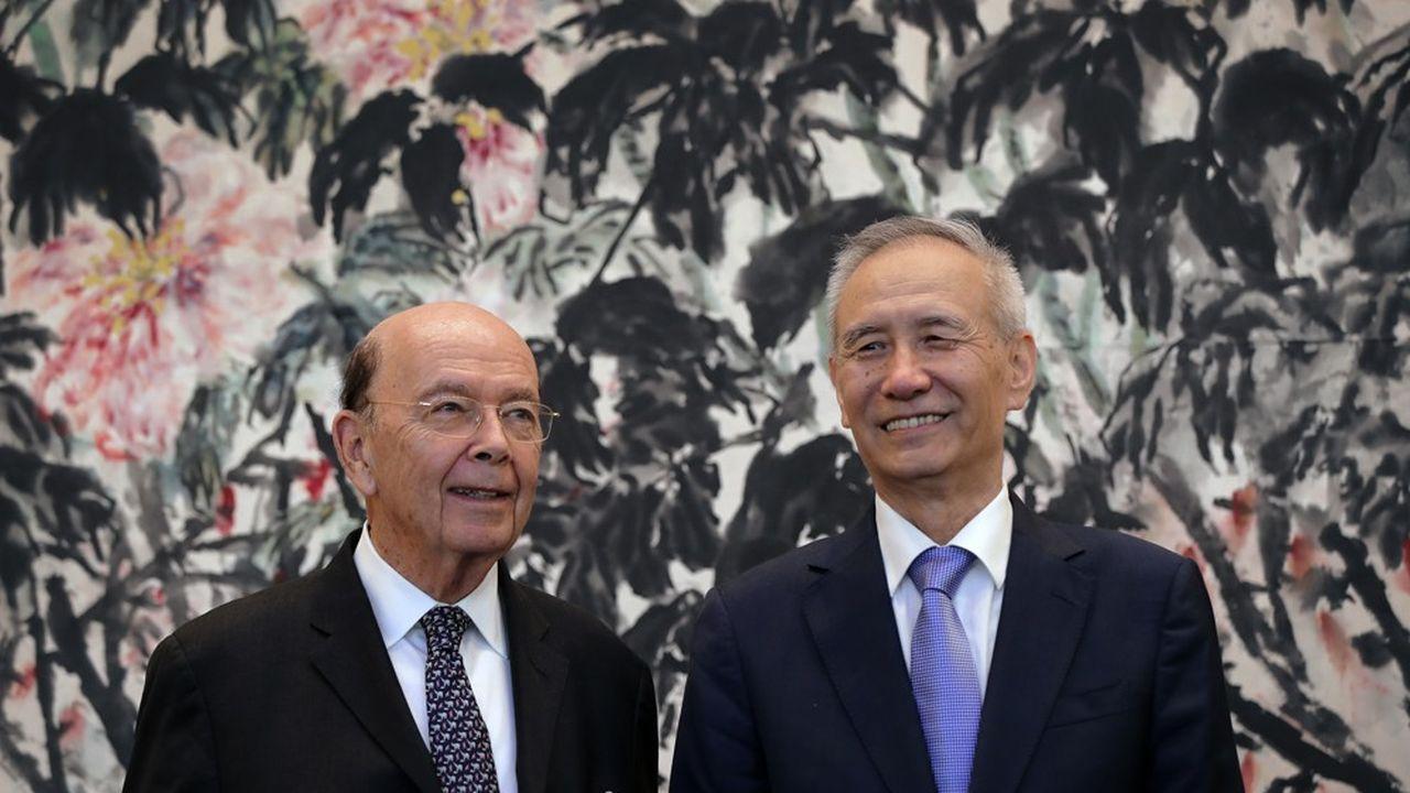 Wilbur Ross, secrétaire au Commerce américain, avait rencontré Liu He, vice-Premier ministre chinois Liu He en juin dernier./AFP PHOTO/POOL/Andy Wong