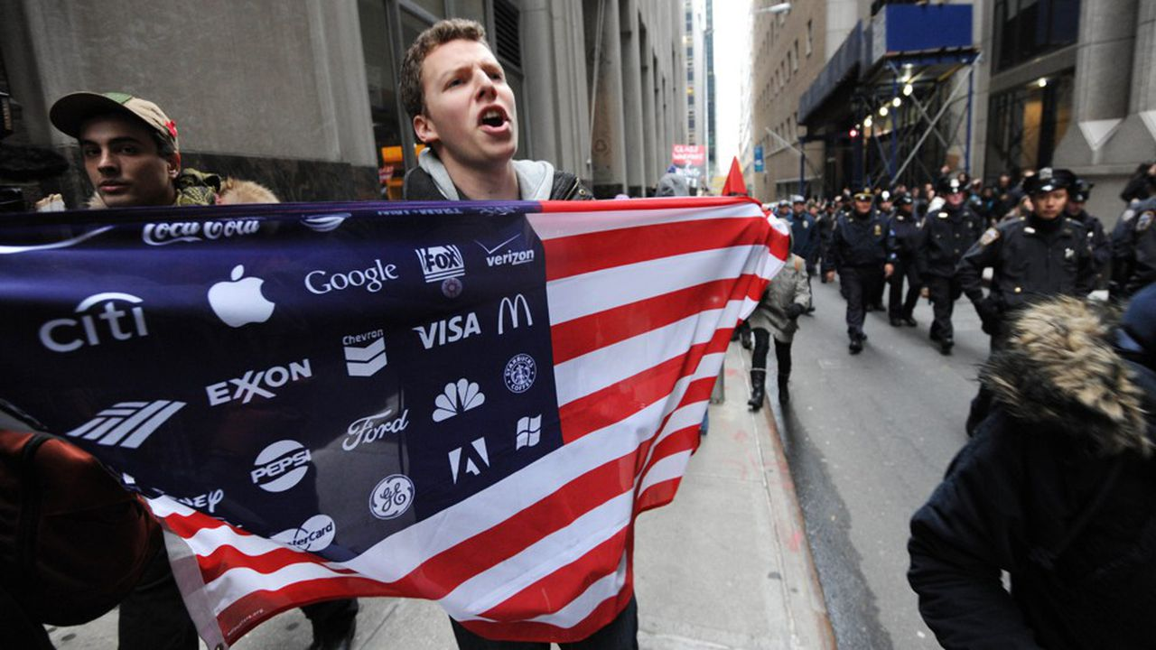 Le 17 septembre 2011, un manifestant d' 'Occupy Wall Street' près du New York Stock Exchange / AFP PHOTO / STAN HONDA