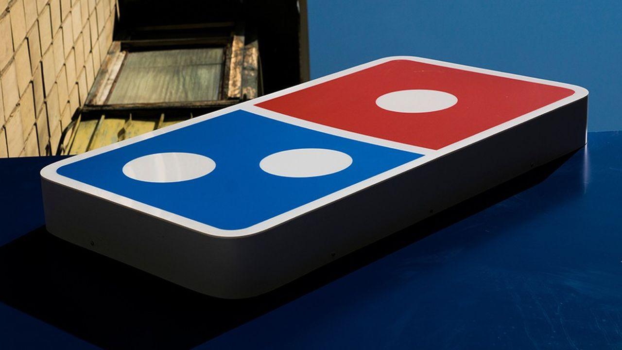 La promotion lancée en Russie par le franchisé russe de Domino's Pizza - une pizza à vie contre un tatouage - a été victime de son succès.