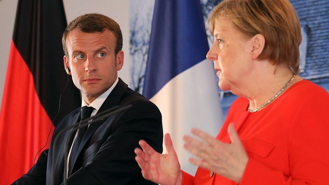 Le président de la République française Emmanuel Macron et la chancelière allemande Angela Merkel lors d'une conférence de presse en juin2018 au Palais Meseberg, dans le nord-est de l'Allemagne.