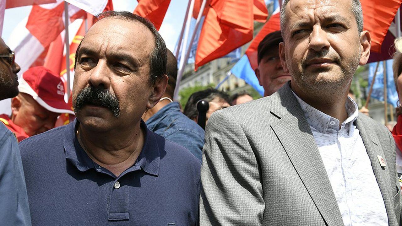 Philippe Martinez, le secrétaire général de la CGT, et Pascal Pavageau, son homologue de Force ouvrière, lors d'une manifestation des cheminots, le 22mai 2018 à Paris.