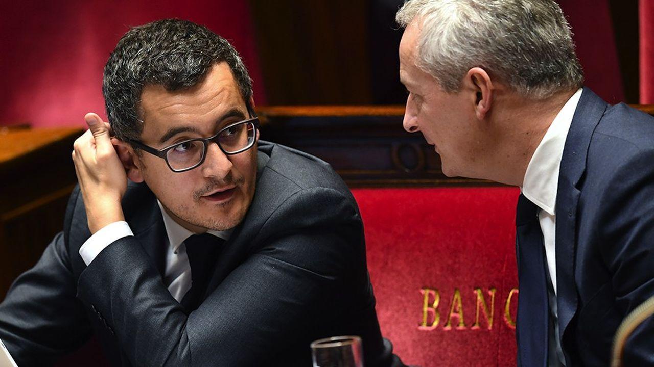 Le ministre des Comptes et de l'Action publique, Gérald Darmanin, avec le ministre de l'Economie, Bruno Le Maire, à l'Assemblée nationale lors du débat budgétaire, le 24octobre 2017