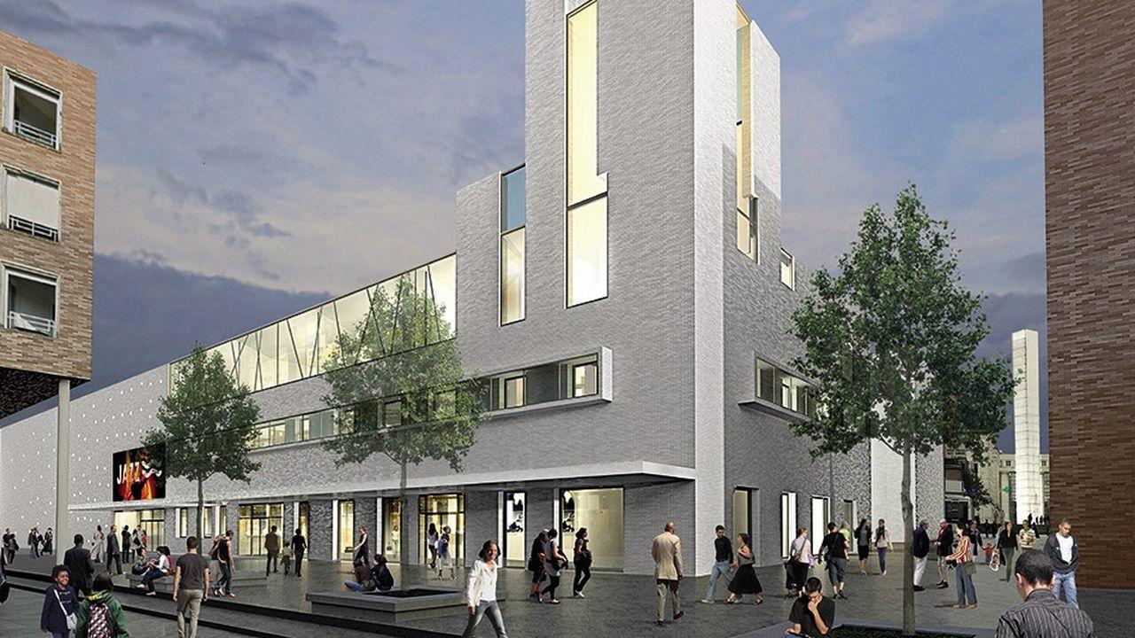 La nouvelle salle de spectacle, construite à la place du gymnase des Roulants, pourra accueillir 800 places assises et 1.500 debout. Le nouveau projet a été confié à l'architecte Jean-Pierre Lott.