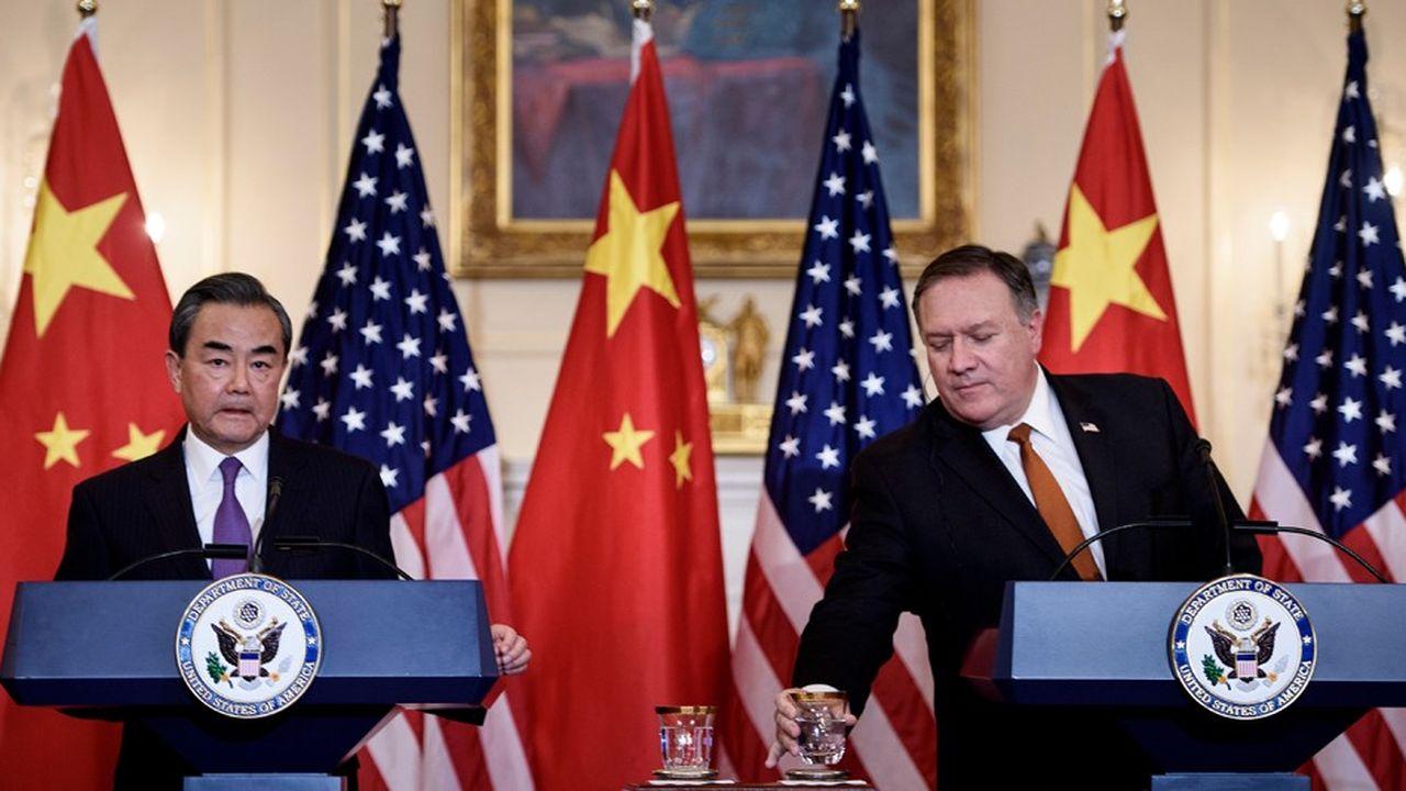 En visite à Washington, le ministre chinoise des Affaires étrangères, Wang Yi (photo: avec Mike Pompeo, son homologue américain) a évoqué un «cas isolé» qu'il ne souhaite pas voir «politisé»