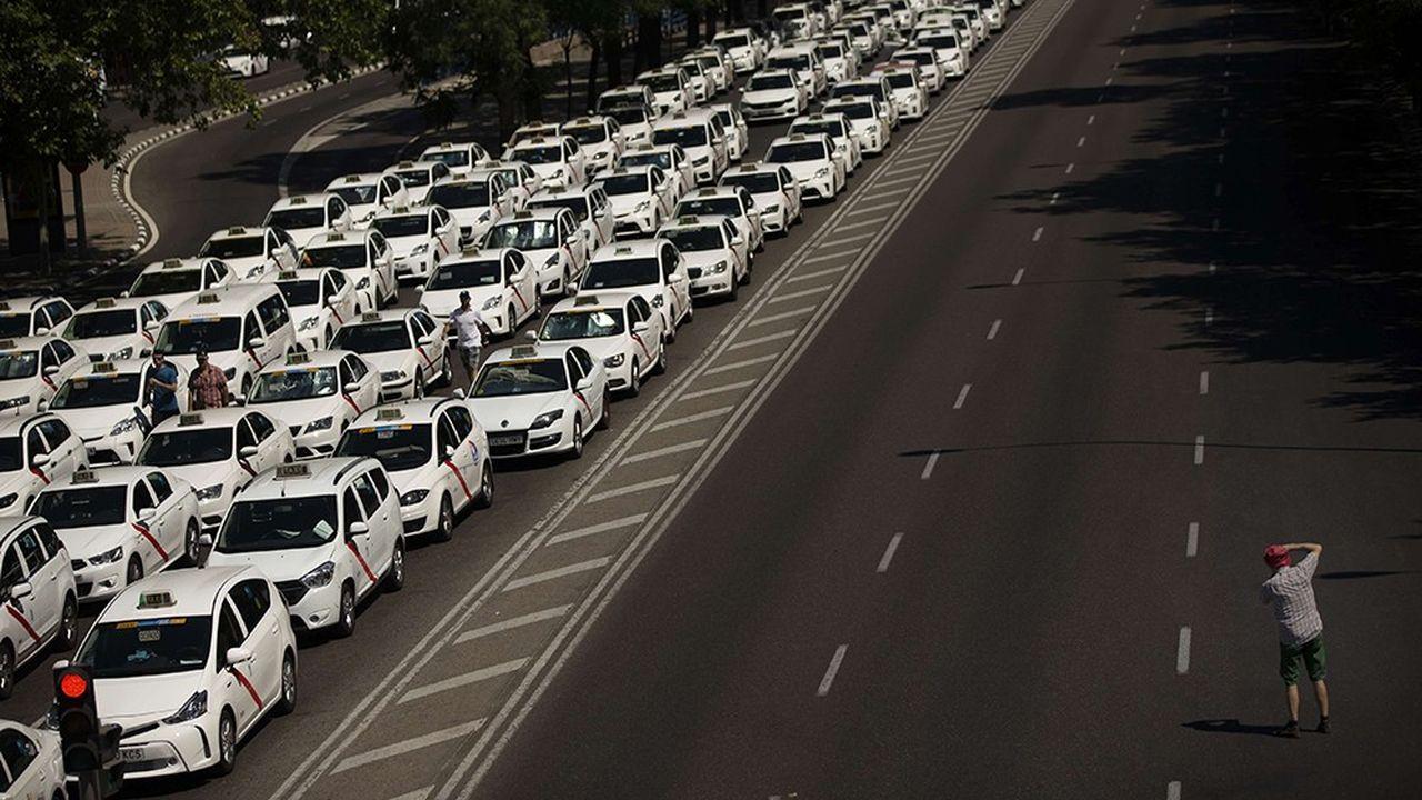 2195998_espagne-les-taxis-obtiennent-gain-de-cause-contre-uber-web-tete-0302067784679.jpg
