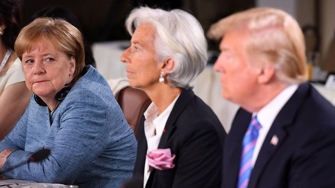 La chancelière allemande Angela Merkel aux côtés de la directrice générale du FMI Christine Lagarde et du président américain Donald Trump lors du sommet du G7, en juin2018