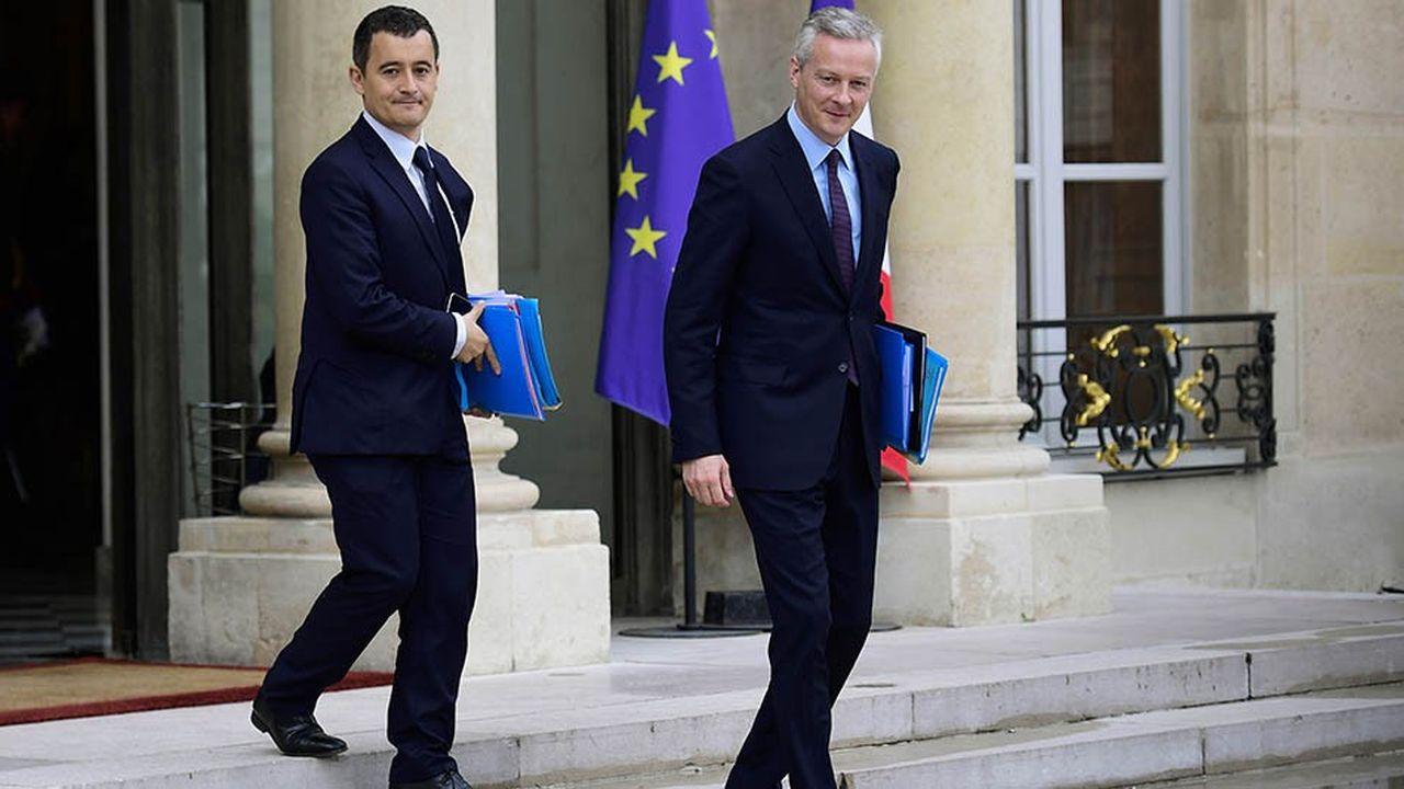 Le ministre de l'Economie Bruno Le Maire et son collègue Gérald Darmanin, ministre des Comptes publics, à la sortie de l'Elysée en juillet2017