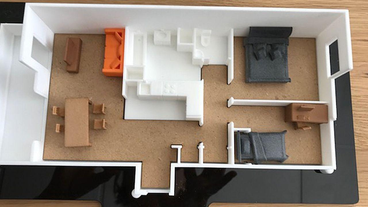 La maquette imprimée en 3D de chaque appartement est équipée de meubles standardisés pour donner un effet d'échelle réaliste.