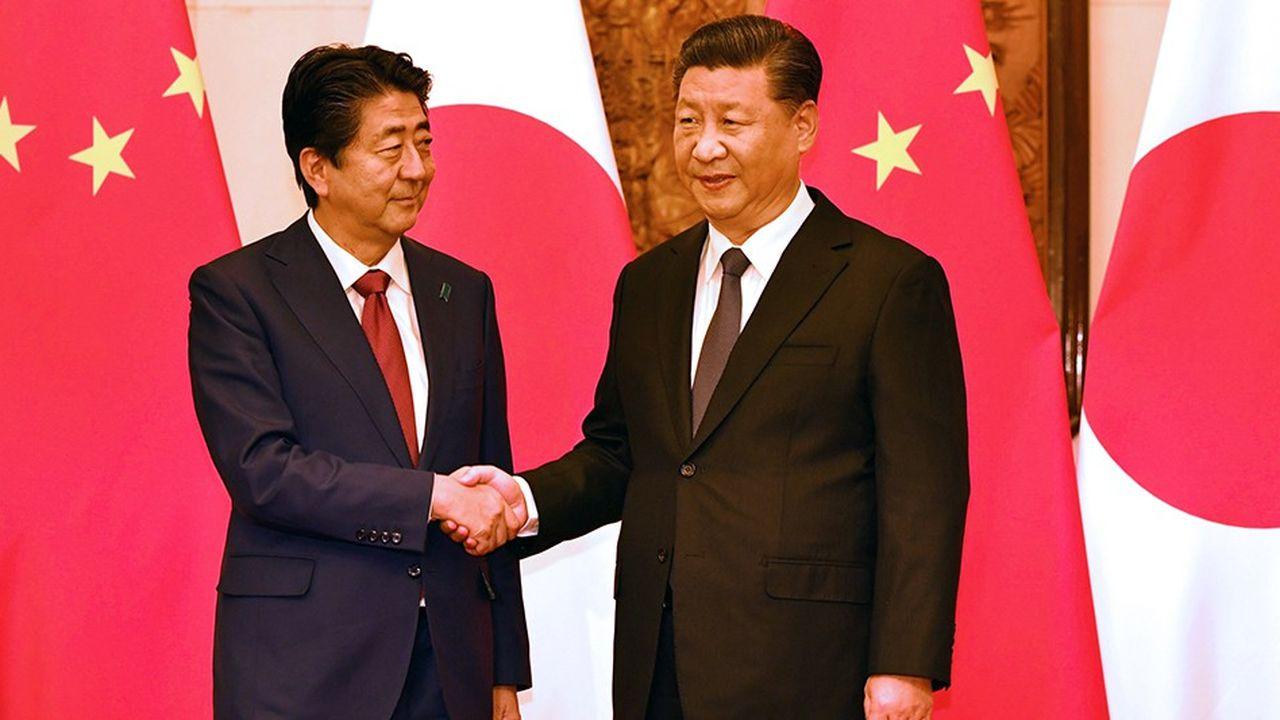 A Pékin, les deux rivaux asiatiques ont multiplié les amabilités pour annoncer qu'ils se voyaient désormais en partenaires plutôt qu'en concurrents ou en adversaires.
