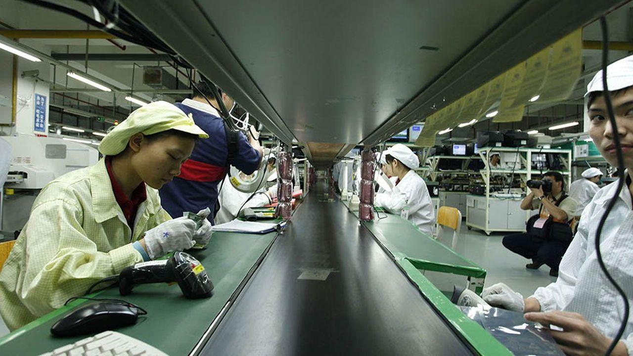 Des ouvriers dans une usine de Foxconn à Longhua, l'un des principaux prestataires d'Apple.