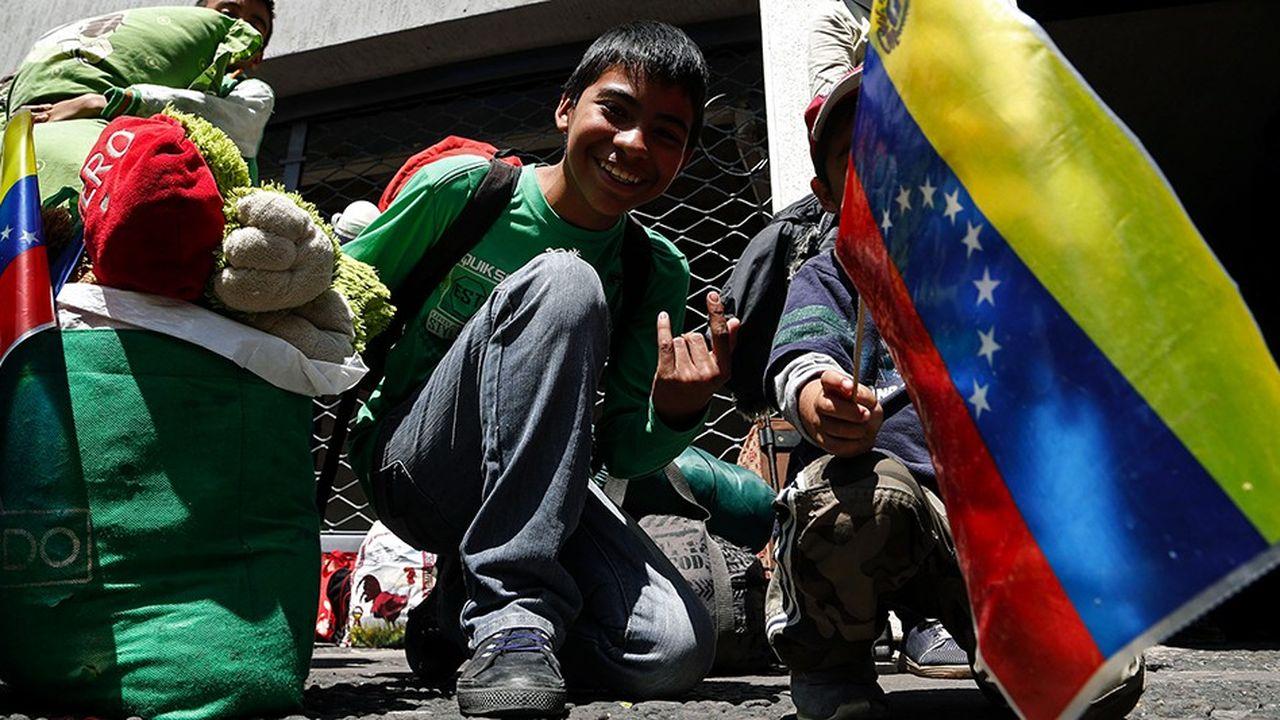 Un groupe de migrants vénézuéliens à Quito, en Equateur.
