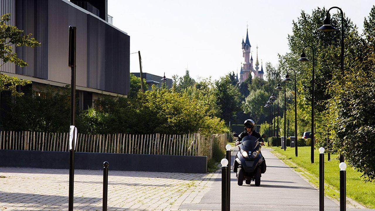 C'est Disney qui décide, en accord avec l'Etat, de l'aménagement des sept communes que compte l'agglomération de Val d'Europe (ici un nouveau quartier d'habitation a Chessy)