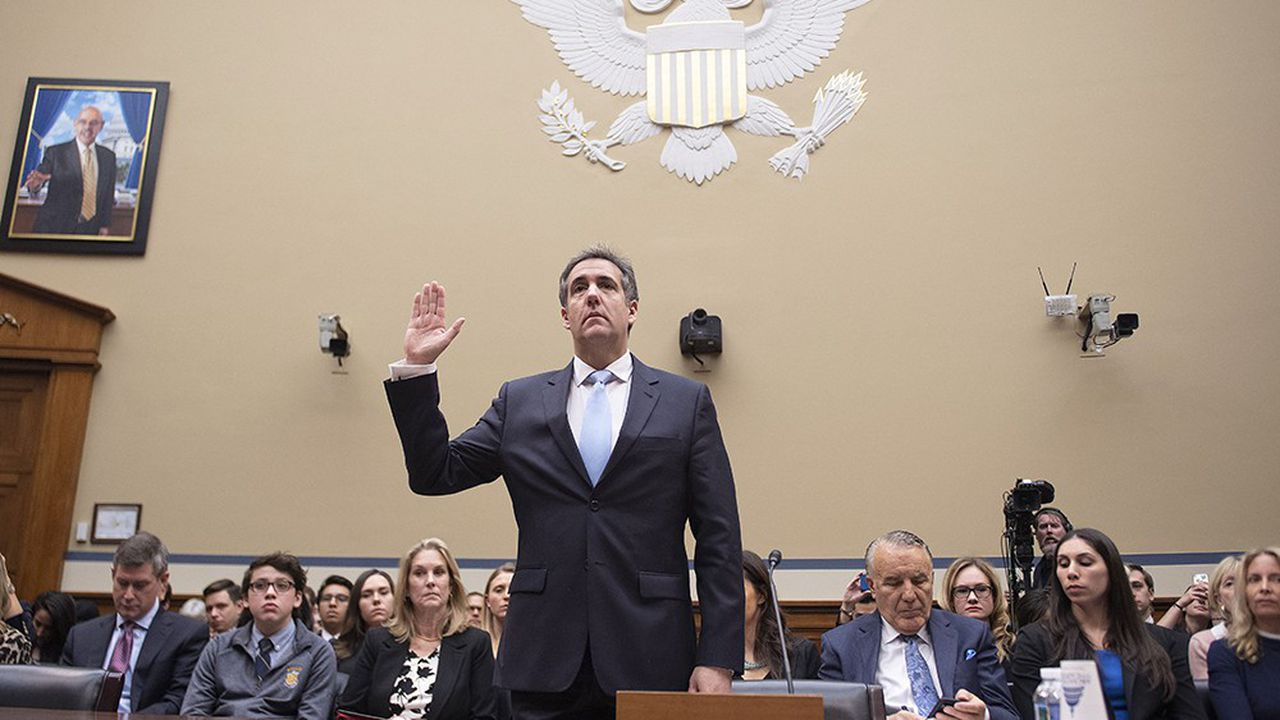 Michael Cohen, US President Donald Trump's former personal attorney, is sworn in to testify before the House Oversight and Reform Committee in the Rayburn House Office Building on Capitol Hill in Washington, DC on February 27, 2019. (Photo by Jim WATSON/AFP)