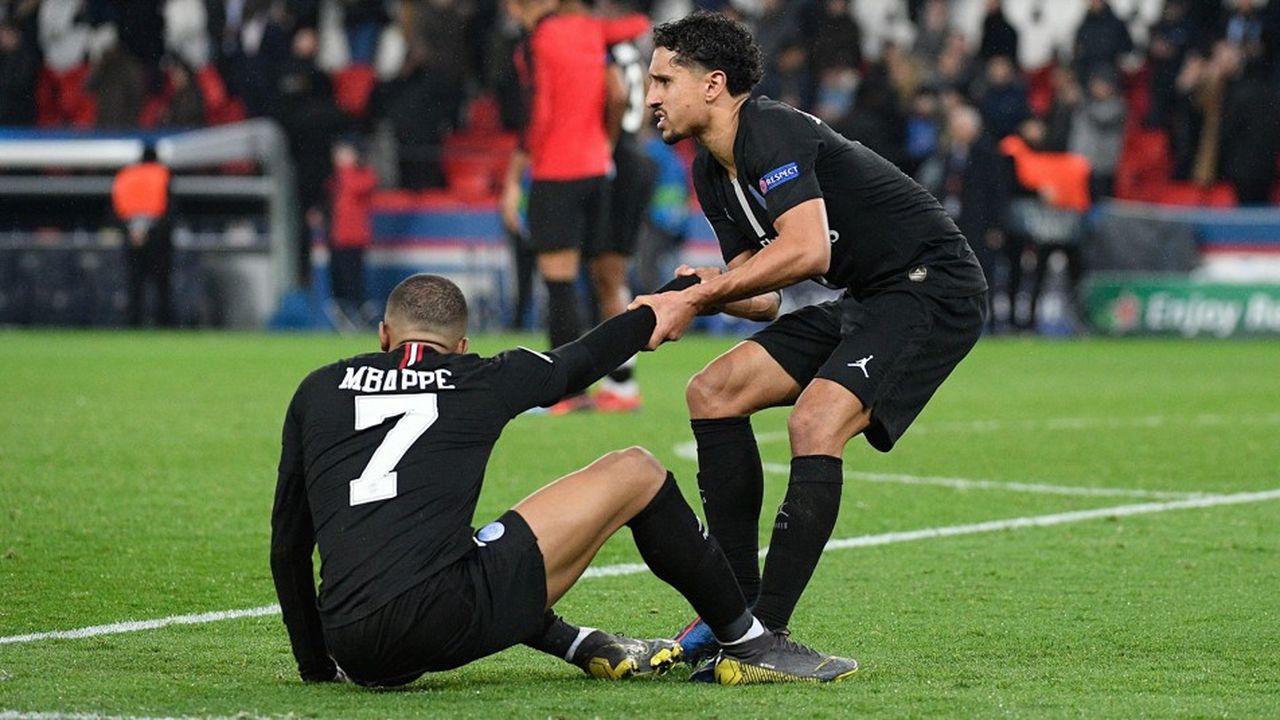 Kylian Mbappe and Marquinhos après l'élimination du PSG en huitième de finale de la Ligue des champions par Manchester United.