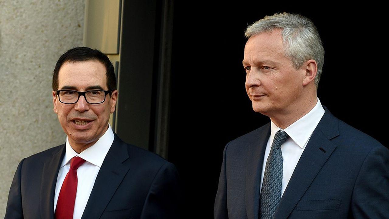 Le secrétaire au Trésor Steven Mnuchin (à gauche) est opposé à une taxation des géants du numérique au niveau national, comme la France l'envisage. Le ministre de l'Economie Bruno Le Maire (à droite) a rappelé mardi que la France «est un Etat libre et souverain qui décide de sa taxation».