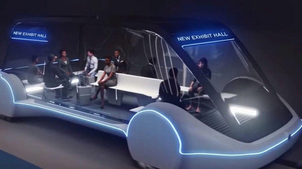 Véhicule électrique autonomecirculant entre les halls d'exposition.