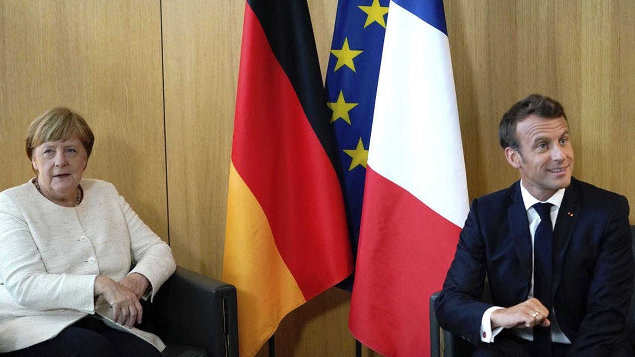 Le président français a gagné une première manche en faisant tomber le système de« spitzenkandidat », rejetant de fait le candidat poussé par la chancelière allemande.