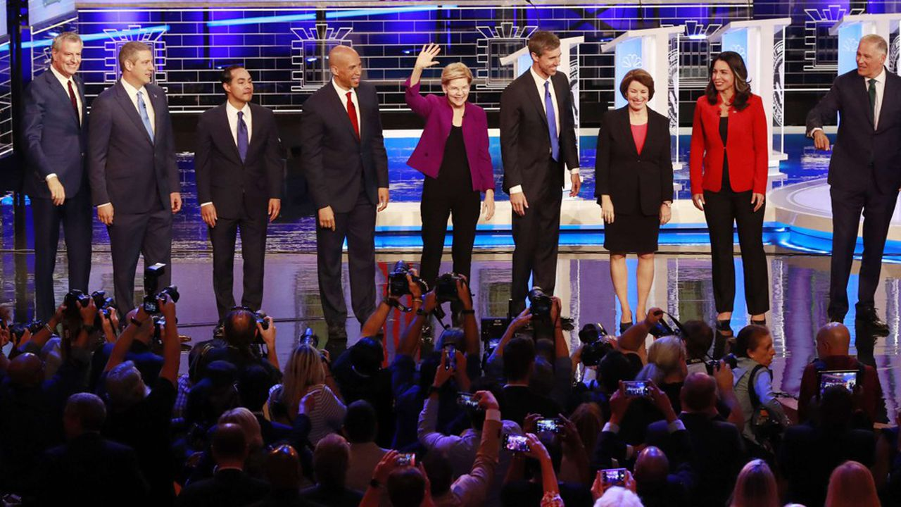 From left, New York City Mayor Bill de Blasio, Rep. Tim Ryan, D-Ohio, former Housing and Urban Development Secretary Julian Castro, Sen. Cory Booker, D-N.J., Sen. Elizabeth Warren, D-Mass., former Texas Rep. Beto O'Rourke, Sen. Amy Klobuchar, D-Minn., Rep. Tulsi Gabbard, D-Hawaii, Washington Gov. Jay Inslee, and former Maryland Rep. John Delaney pose for a photo on stage before the start of a Democratic primary debate hosted by NBC News at the Adrienne Arsht Center for the Performing Arts, Wednesday, June 26, 2019, in Miami. (AP Photo/Wilfredo Lee)/MHX104/19178041778994/1906270319