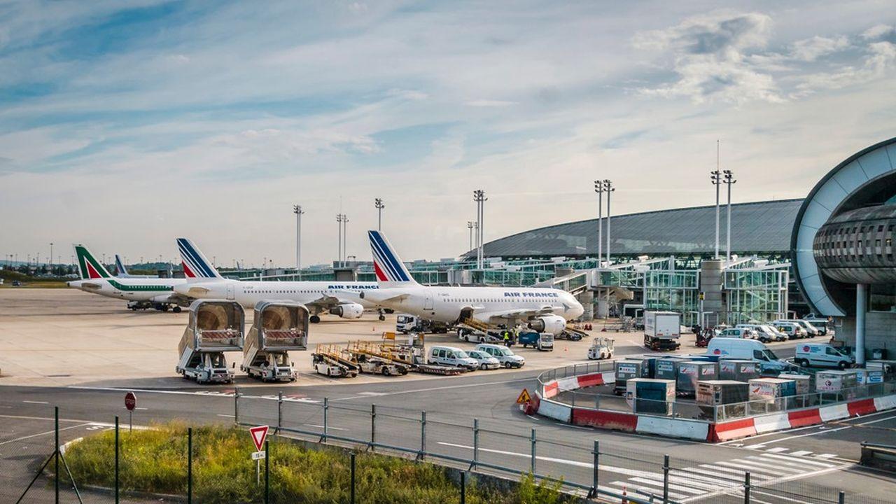 Une écotaxe de 1,50 à 18 euros sur les billets d'avion — France