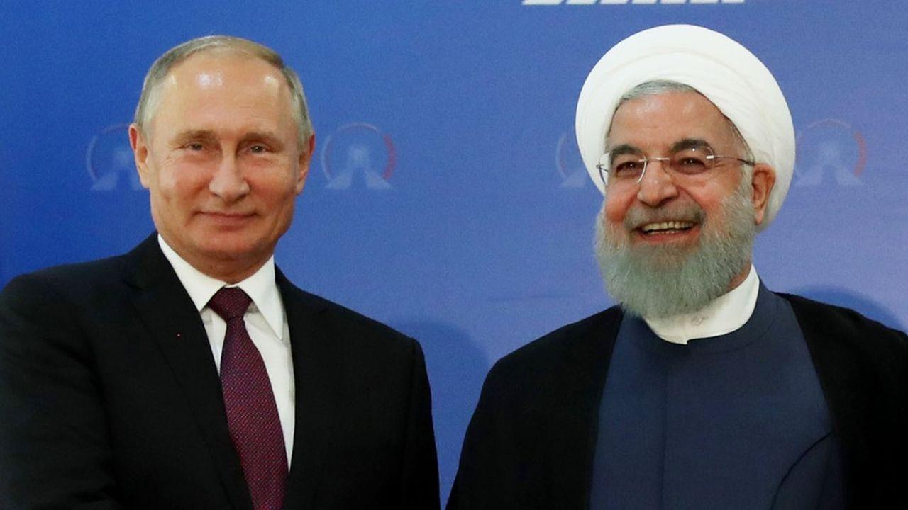 La Russie dirigée par Vladimir Poutine est une alliée stratégique de l'Iran, dont le président est Hussein Rohani.