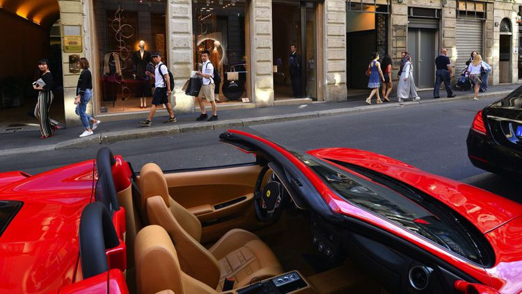 Italy, Lombardy, Milan, Fashion Quadrilateral, a Ferrari in Via Monte Napoleone