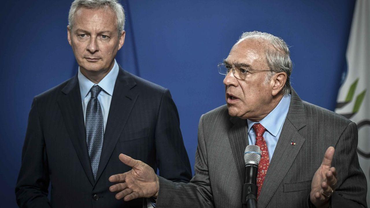 Bruno Le Maire, ici aux côtés du secrétaire général de l'OCDE, Angle Gurria, se rendra la semaine prochaine à Washington pour rencontrer son homologue américain, Steven Mnuchin.