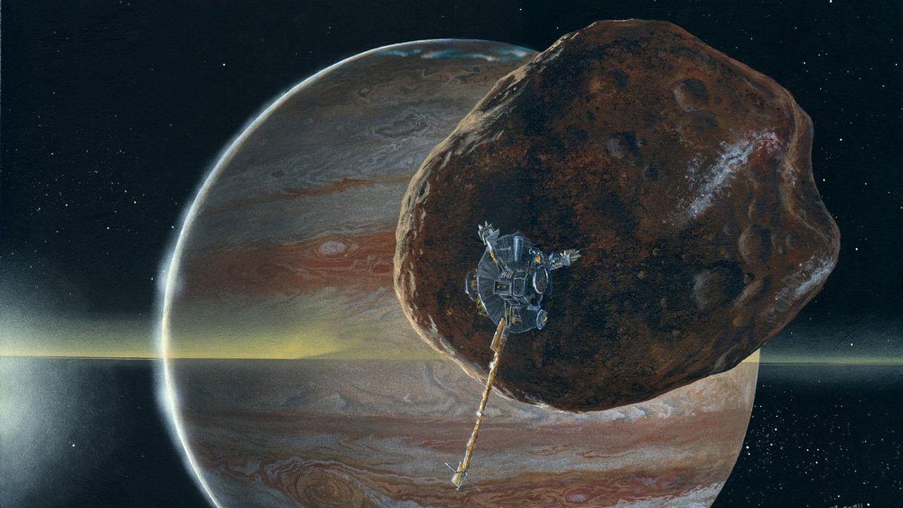 Vue d'artiste d'un satellite Galileo passant devant la petite lune de Jupiter, Amalthea.