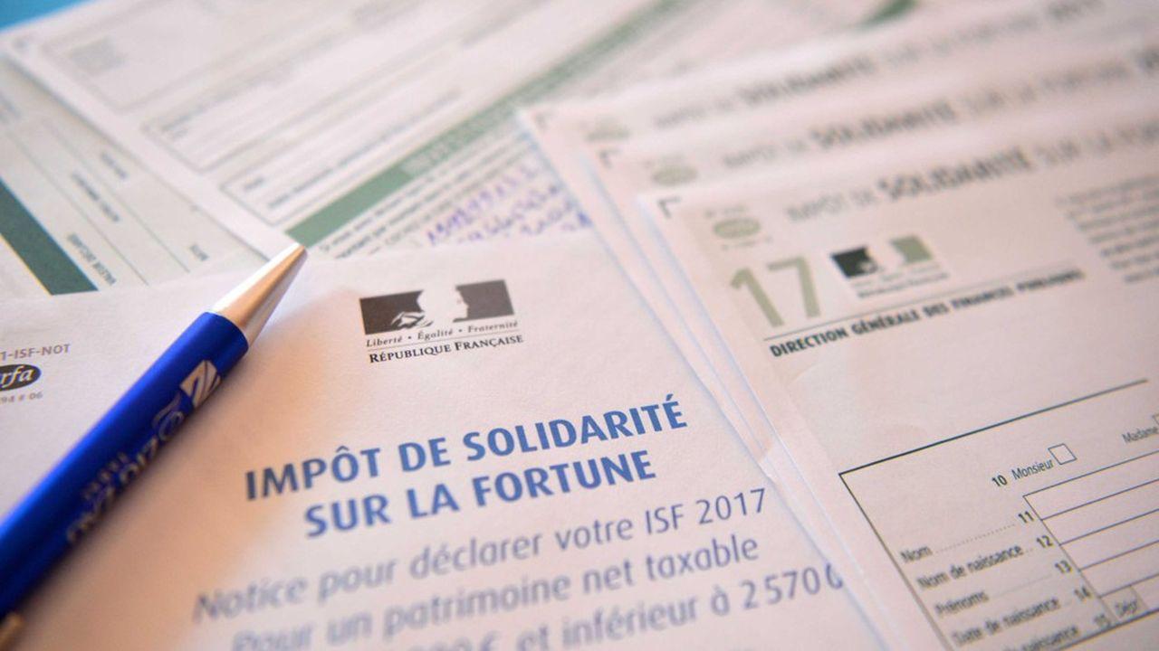 Le comité d'évaluation de la réforme de la fiscalité du capital a publié son premier rapport dans un contexte de pression politique forte.