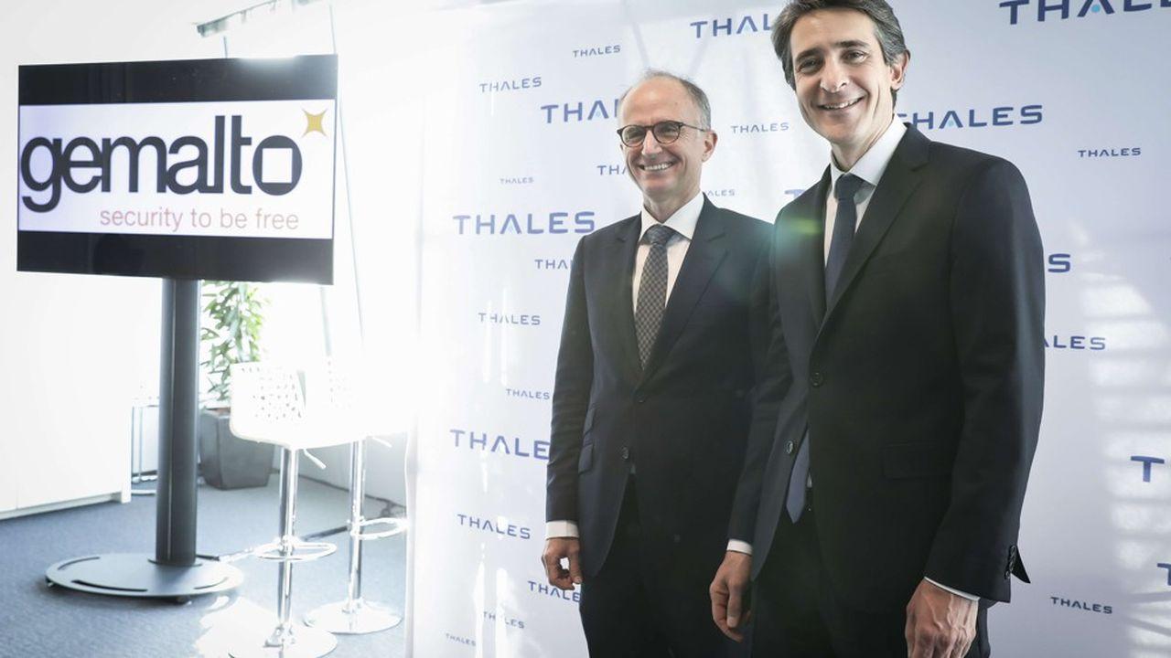 Avec Gemalto, Thales aurait compté 80.000 salariés et dégagé 19milliards d'euros de chiffre d'affaires en 2018.Philippe Vallée, patron de Gemalto (à gauche), reste au coté du PDG de Thales, Patrice Caine.