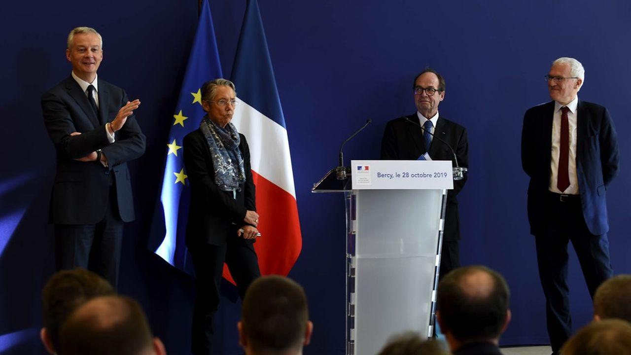 Après la remise du rapport de Jean-Martin Folz (derrière le pupitre) sur la construction de Flamanville, les ministres Bruno Le Maire (à gauche) et Elisabeth Borne ont demandé un «plan d'action» à Jean-Bernard Lévy, le patron d'EDF (à droite).
