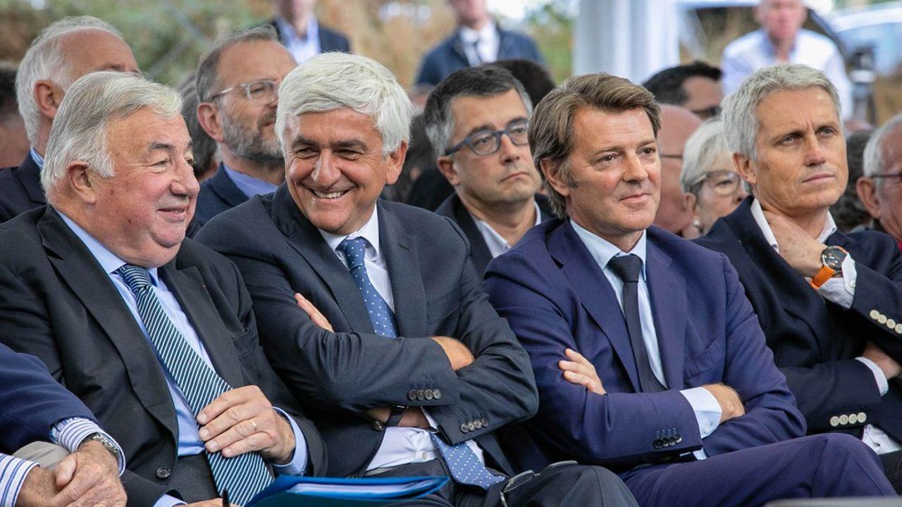 Gérard Larcher, Hervé Morin et François Baroin. (Photo by LOU BENOIST / AFP)