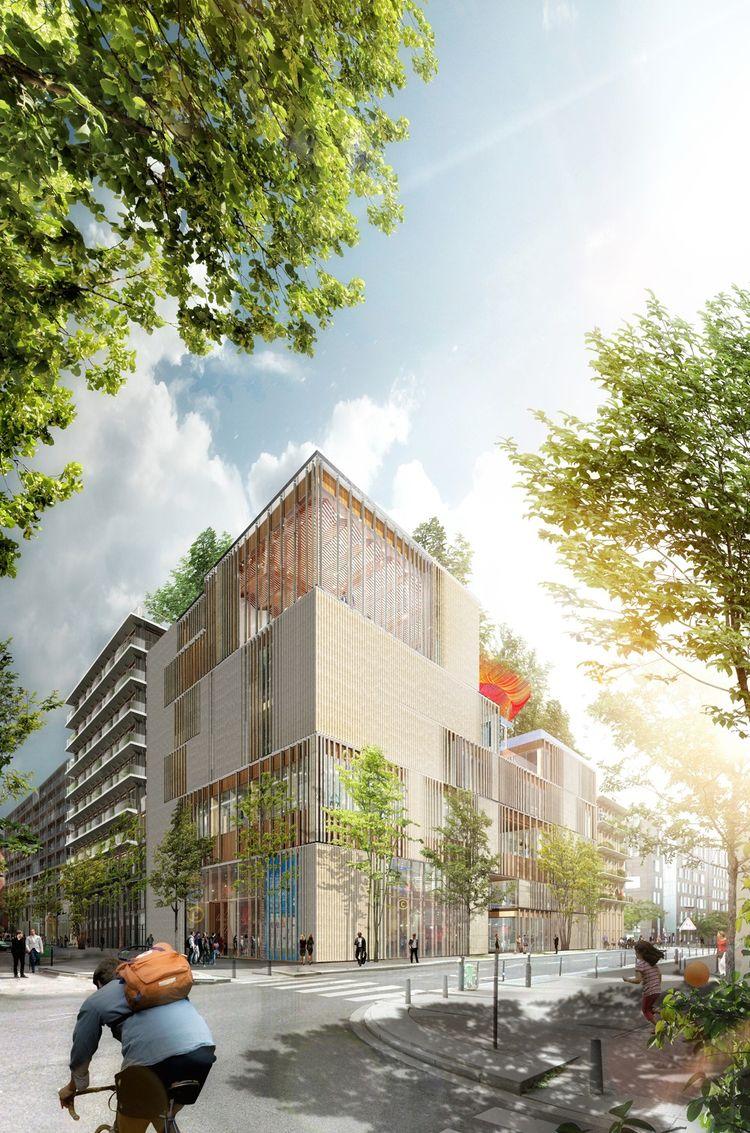 Situé au-dessus des voies SNCF dans le XIIIe arrondissement, à deux pas de Station F, cet immeuble de six étages abritera l'université américaine mais aussi des logements et des commerces. .