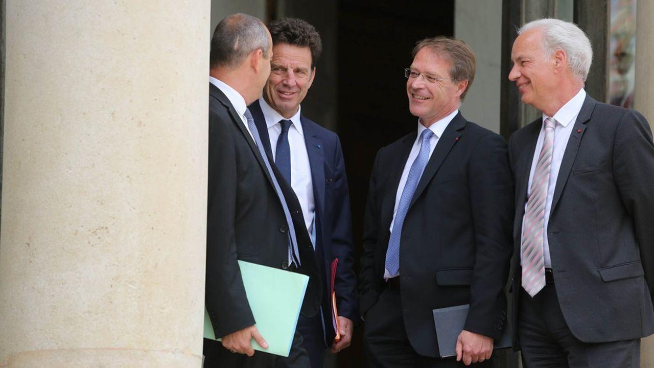 De gauche à droite, après Laurent Berger (CFDT), de dos : Geoffroy Roux de Bezieux, président du Medef, Francois Asselin, président de la CPME, et Alain Griset, président de l'U2P.