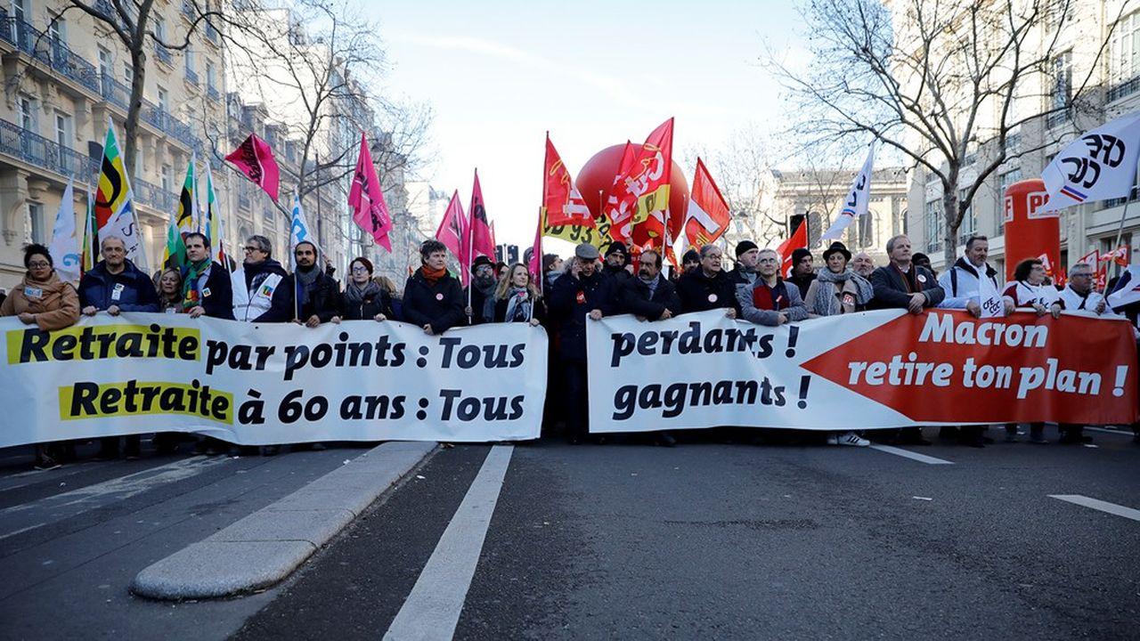 Philippe Martinez (CGT) et Yves Veyrier (FO) lors de la manifestation en Paris du 16janvier.