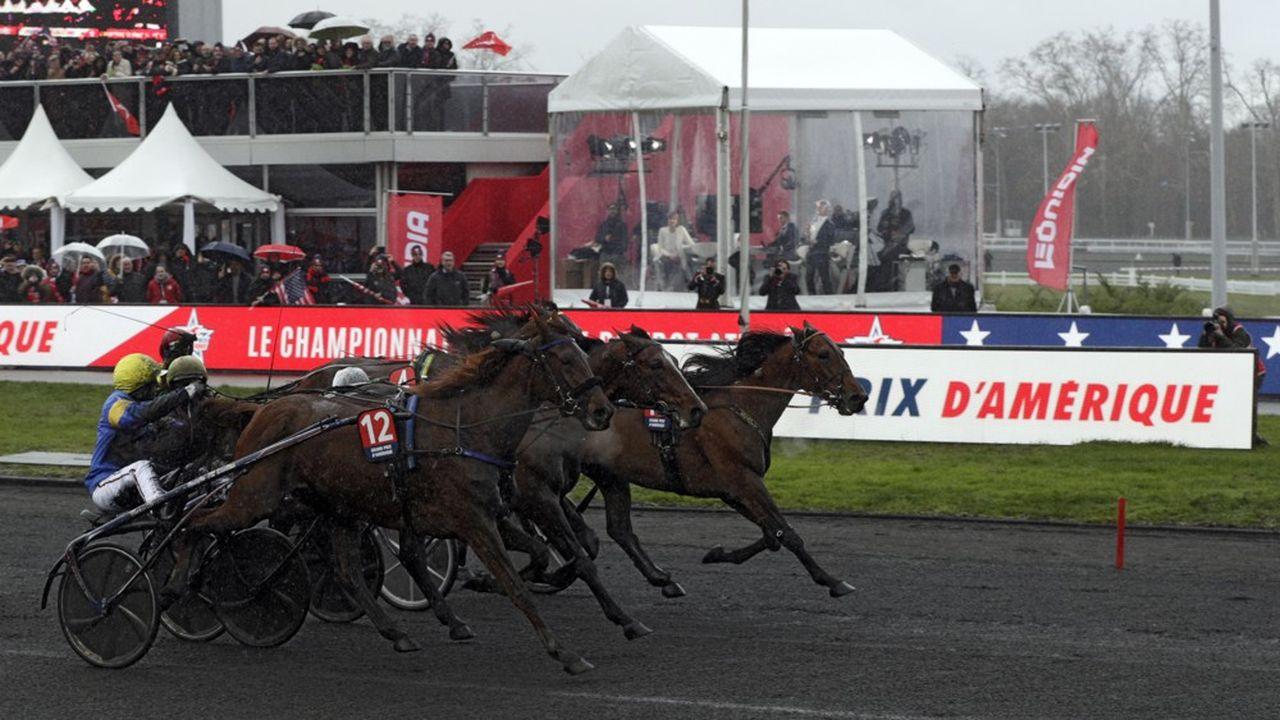 Vainqueurs du dernier Grand Prix d'Amérique, le célèbre «driver» Jean-Michel Bazire et Belina Josselyn (numéro12 sur la photo) défendront leur titre ce dimanche.
