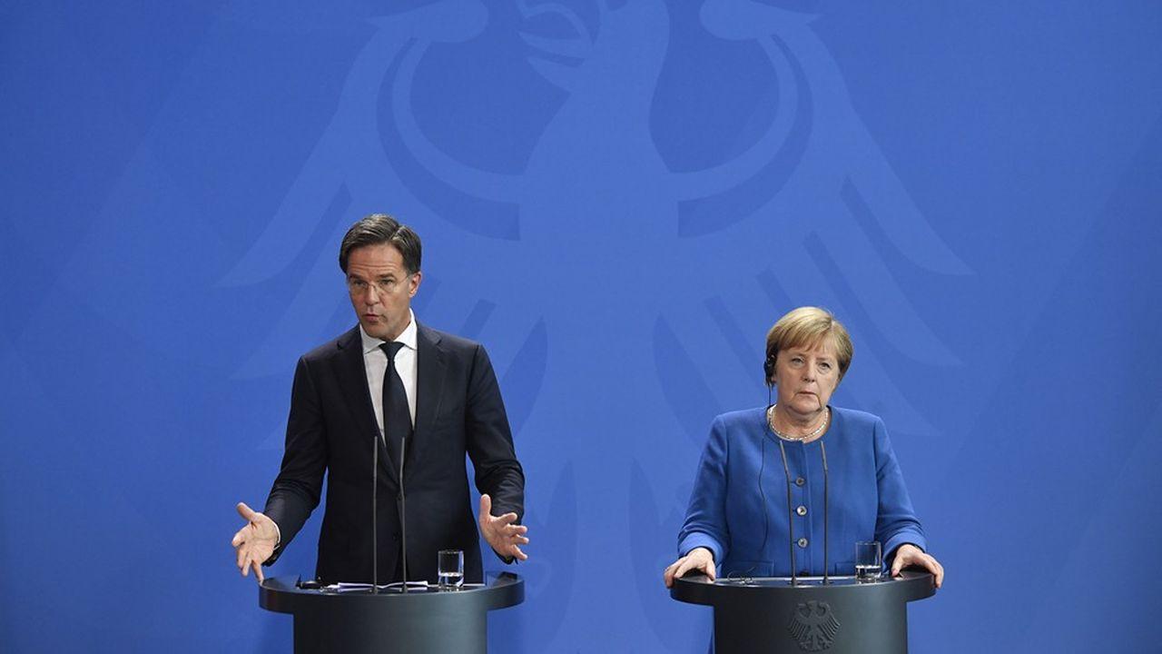 La chancelière allemande, Angela Merkel, et le Premier ministre néerlandais, Mark Rutte, tiennent une conférence de presse après un sommet bilatéral, le 2octobre 2019 à Berlin.