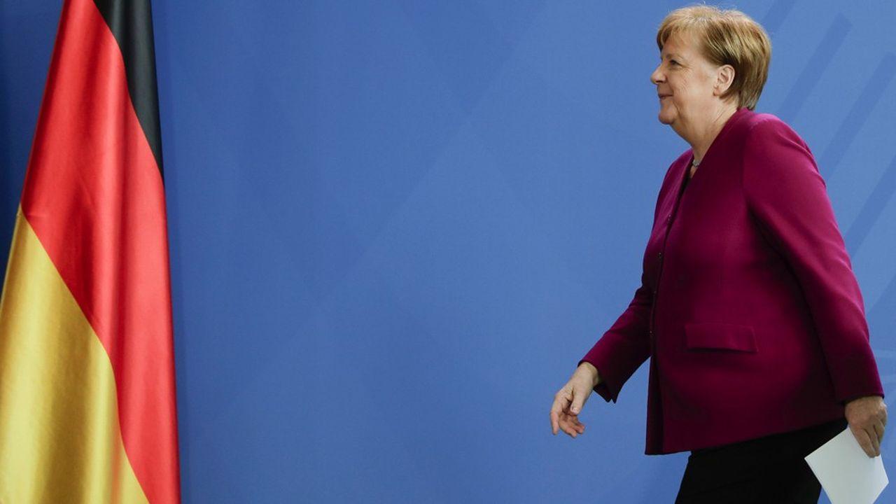 «Notre succès est provisoire», a martelé Angela Merkel mercredi soir en présentant un plan de sortie très progressif du confinement du pays. (Photo by Markus Schreiber/POOL/AFP)
