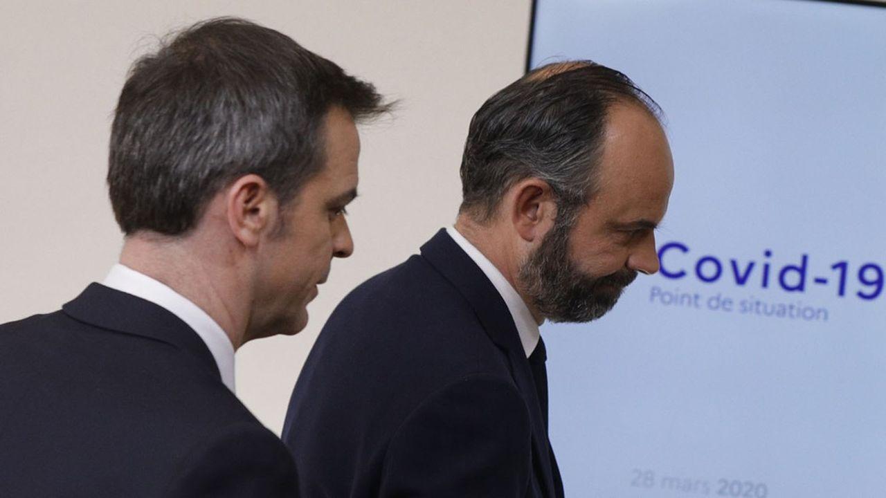 En première ligne, Olivier Véran, le ministre de la Santé (à gauche, avec Edouard Philippe, le Premier ministre), se voit chargé, seul ou avec un autre ministre, de 7 des 17 chantiers du déconfinement.