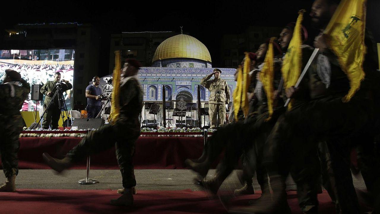 Le Hezbollah, qui défile ici le 31mai 2019 devant le dôme du Rocher, à Jérusalem-Est, est devenu un élément militaire et politique incontournable au Liban. Une loi américaine pourrait le conforter à réclamer un recentrage vers «l'est».