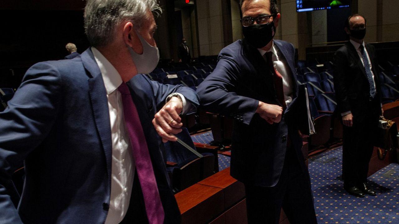 Le président de la Fed Jerome Powell et le secrétaire au Trésor Steve Mnuchin lors de leur audition à la Chambre des Représentants, mardi.