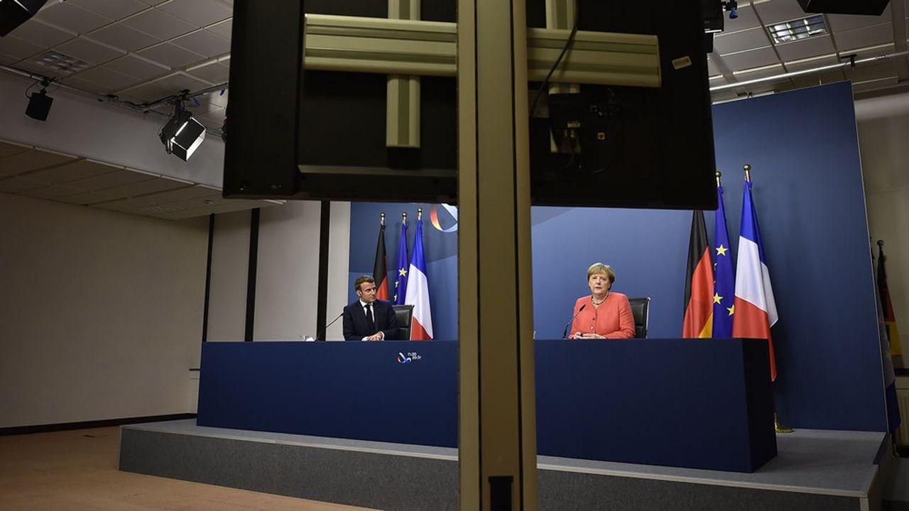 La chancelière Angela Merkel et le président Emmanuel Macron lors d'une conférence de presse, mardi au petit matin.