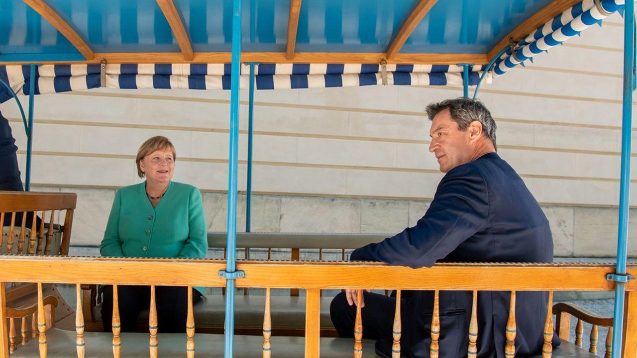 La chancelière Angela Merkel et le président de la région de Bavière, Markus Söder, ont affiché leur entente lors d'une rencontre à Prien, sur le lac deChiemsee, le 14juillet dernier.