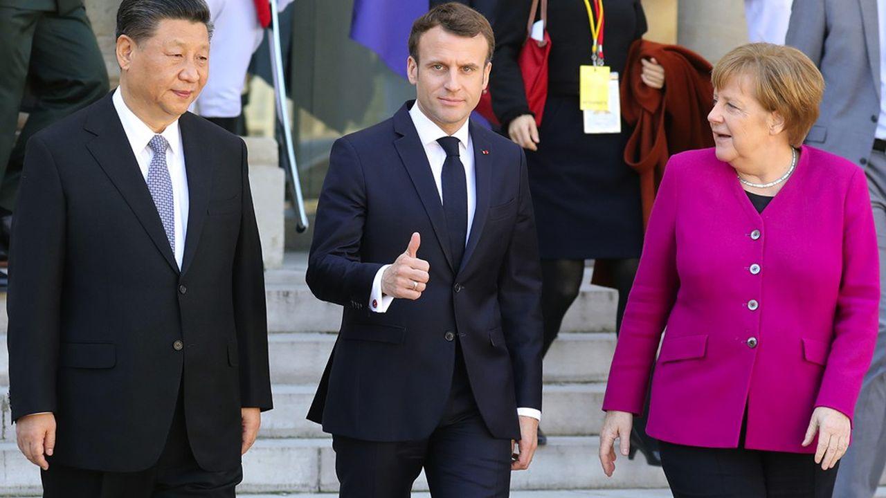 Emmanuel Macron, Angela Merkel et le président chinois Xi Jinping à Paris le 26mars 2019.