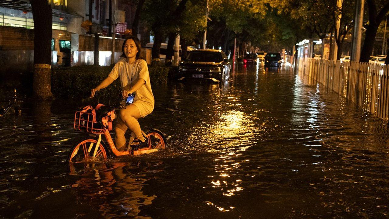 Pékin a fermé parcs et sites touristiques dans l'attente des pluies torrentielles qui doivent s'abattre sur la ville entre mercredi et jeudi