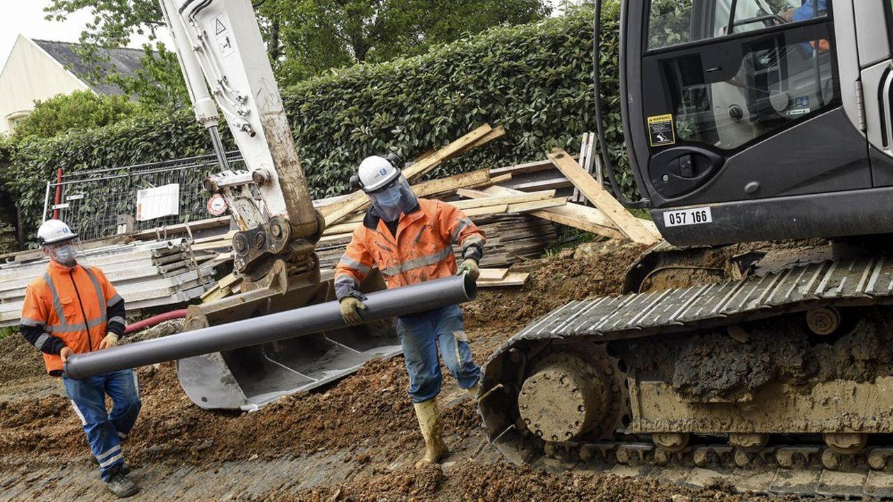 Des salariés du bâtiment sur un chantier.
