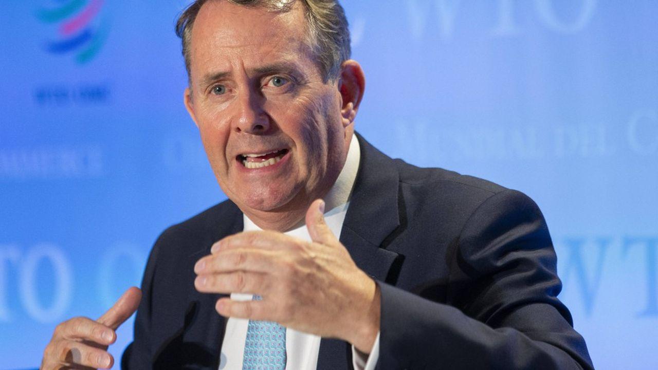 Pour Liam Fox, l'OMC doit changer de stratégie pour éviter une escalade des tensions commerciales et des barrières tarifaires.