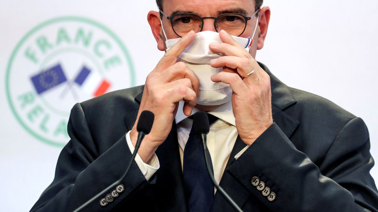 French Prime Minister Jean Castex adjusts his face mask during a news conference to present his government's economic recovery plan from the Covid-19 pandemic, in Paris, France September 3, 2020. Ludovic Marin/Pool via REUTERS
