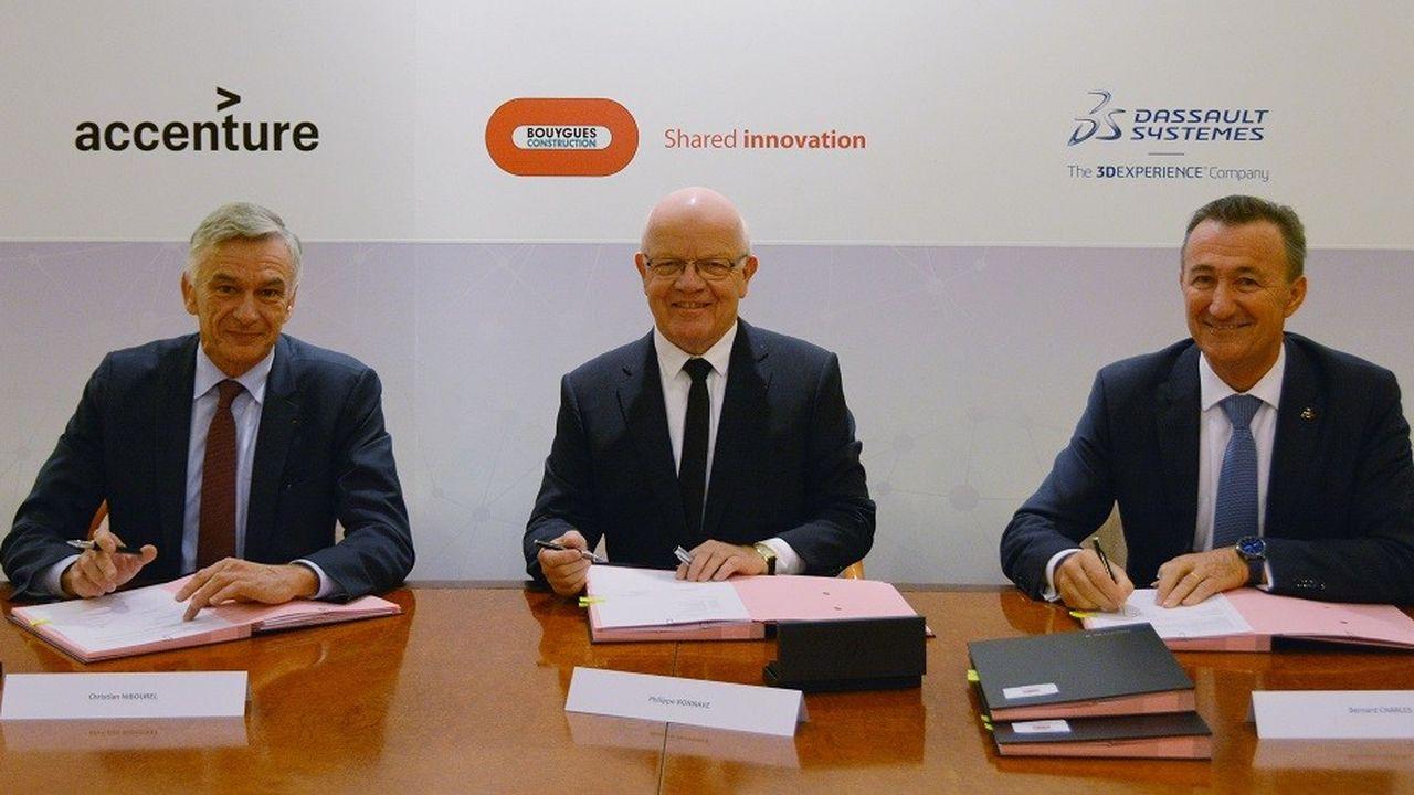 Bernard Charlès, directeur général de Dassault Systèmes, Philippe Bonnave, PDG de Bouygues Construction, et Christian Nibourel, président d'Accenture en France, lors de la signature du contrat.