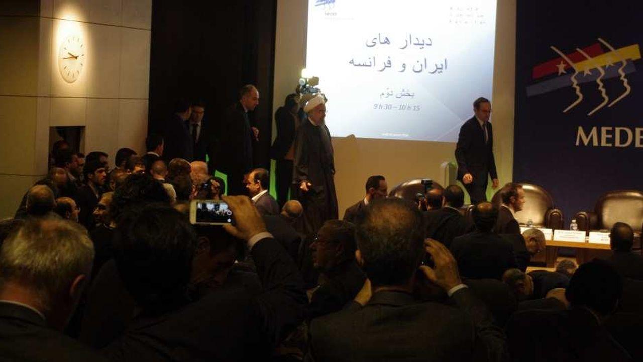. A 10h30, accueilli tel une rockstar, Hassan Rohani, le président iranien, a fait son entrée, sous les applaudissements dans l'auditorium du Medef, à Paris, accompagné de Manuel Valls